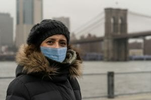 woman wearing surgical mask in new york, in Dumbo neighborhood