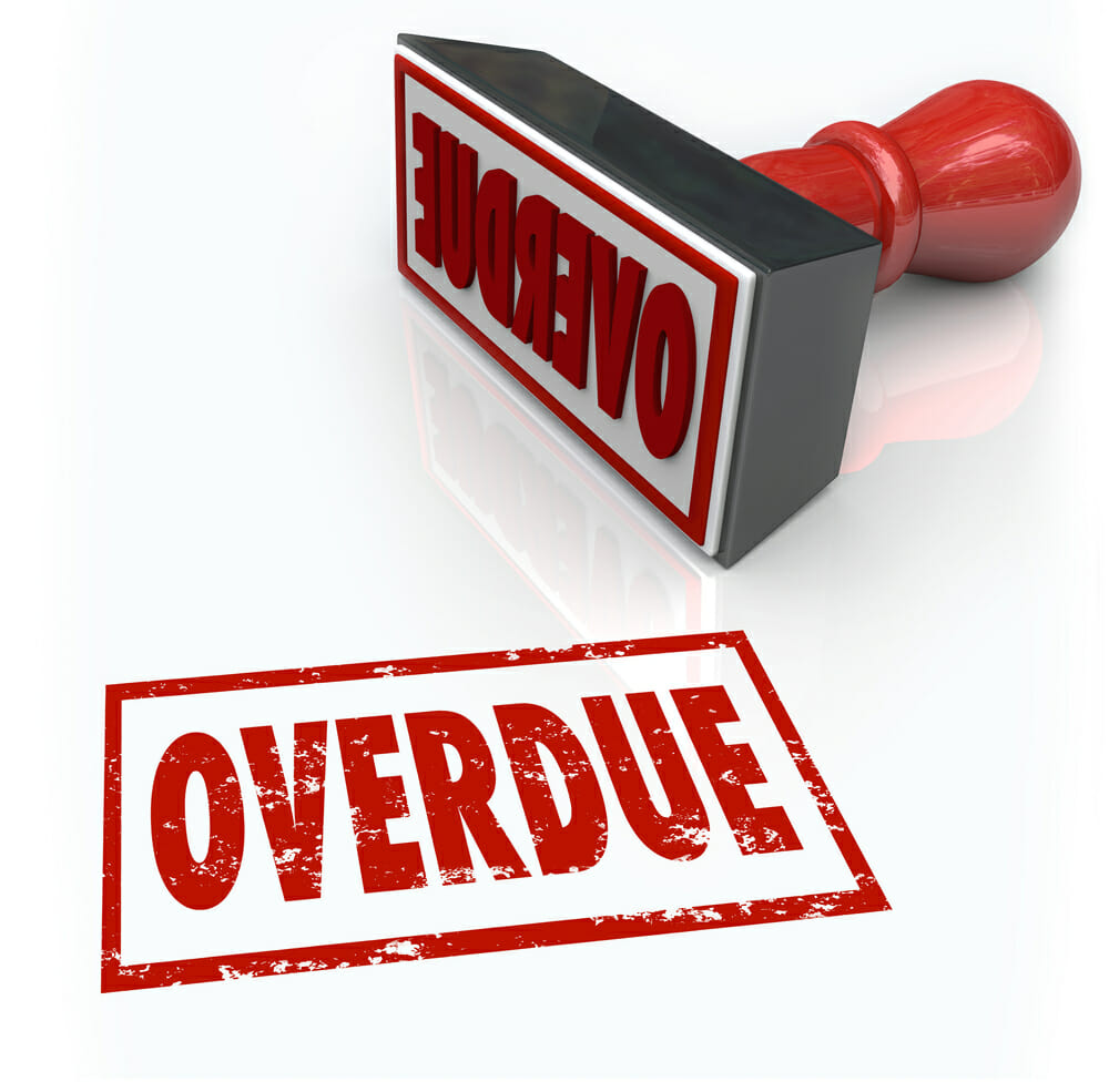 Overdue word in a red stamp to illustrate a late or missed payment or delayed response past a deadline